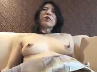 Horny mature rubs her hairy..