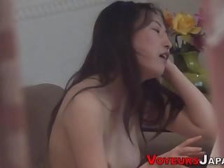 Japanese babe rides dick