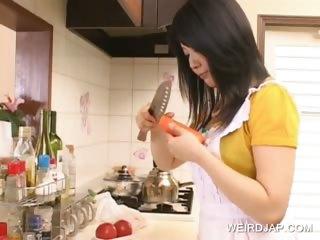 Asian hottie having fun in..